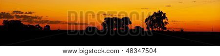 farm silhouette at dawn, wide panorama