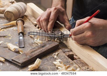 Carpenter Taking Measurement