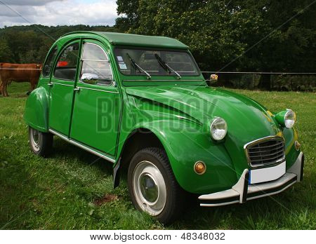 BEAULIEU, FRANCE - JULY 23: (Ed Note: License Plate Altered) A green citroen 2 CV on show on July 23, 2007 in Beaulieu, France. The 2CV is not longer in production and considered a collector's piece.