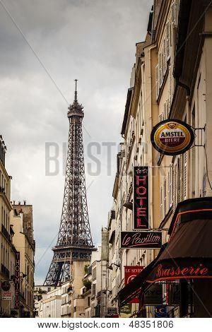 Parisian Street Against Eiffel Tower In Paris, France