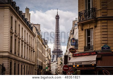 Parisian Street Against Eiffel Tower In Paris, France