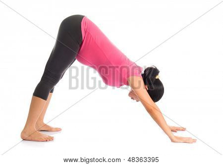 Prenatal yoga meditation. Full length healthy Asian pregnant woman doing yoga meditation at home, full body isolated on white background. Yoga facing downward dog positions.