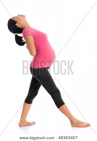 Prenatal yoga. Full length healthy Asian pregnant woman doing yoga exercise stretching at home, full body isolated on white background. Yoga positions.