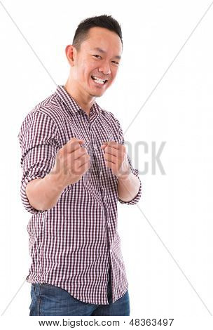 Asian man in kungfu fighting mood, isolated on white in studio.