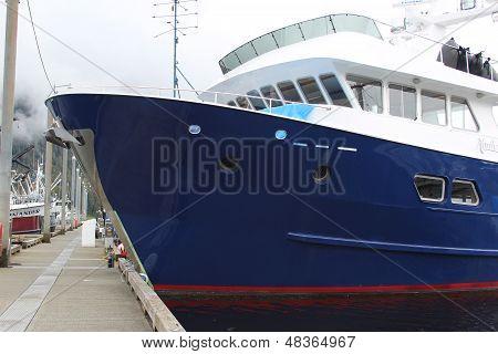 Blue Ship in Alaska Harbor