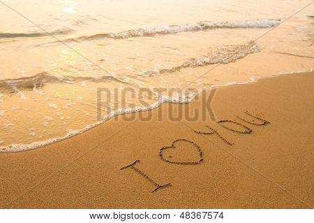 I love You - inscription on the beach sand, soft surf wave.