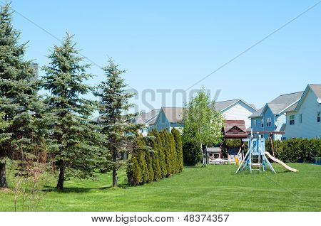 A Typical American Backyard With Child Playground