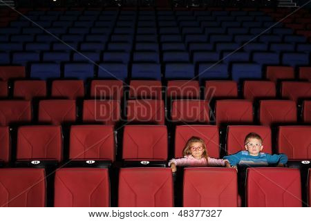 Two children in an empty cinema hall