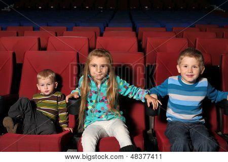 Happy little children together watching a movie