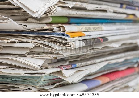 a closeup shot of pile of newspapers