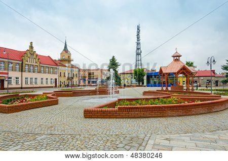 LUBACZOW, POLAND-JULY 14 : general view of market square with recently renovated thanks to EU funds town hall buildings and ancient well, Lubaczow, Poland, circa 14 July 2013