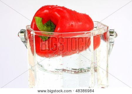 fresh red sweet pepper in water