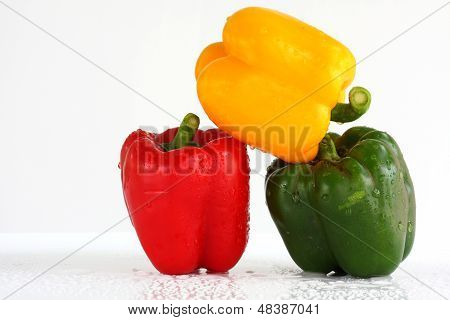 three fresh sweet pepper isolated and white blackgroung