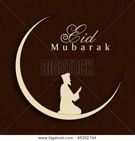 Eid Mubarak concept with silhouette of Muslim man praying (Namaz, Islamic prayer) on abstract brown background.