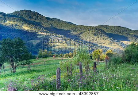 Wooden stick fence in village in mountains