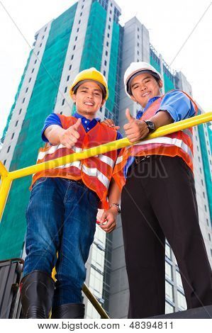 Chinese architect and supervisor on a construction site