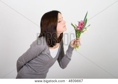 Woman Standing And Holding  Bouquet