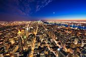stock photo of freedom tower  - New York City and New Jersey skyline at night w the Freedom tower and Brooklyn bridge - JPG