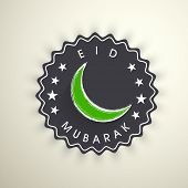 Tag, sticker or label with moon on grungy colorful background for Muslim community festival Eid Muba
