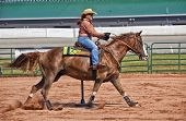 picture of barrel racing  - Western horse and rider competing in pole bending and barrel racing competition - JPG