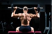 stock photo of dumbbell  - Strong man  - JPG