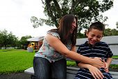 foto of tickle  - mother tickling child at park and laughing - JPG