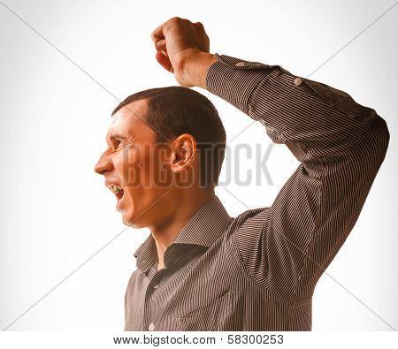 man raises his fist beating violence