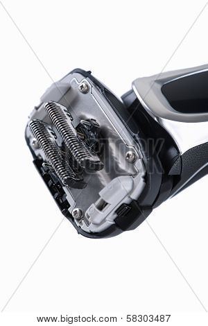 Closeup Image Of The Blades Of Fashionable Electric Shaver On White