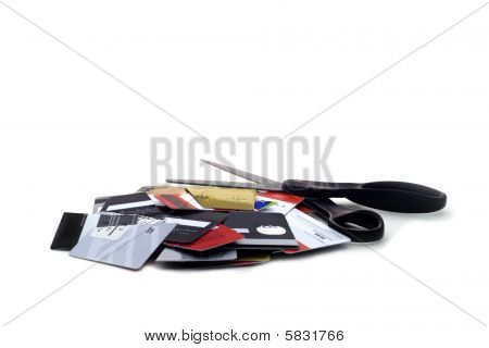 Cut Up Credit Cards With Scissors On White Background