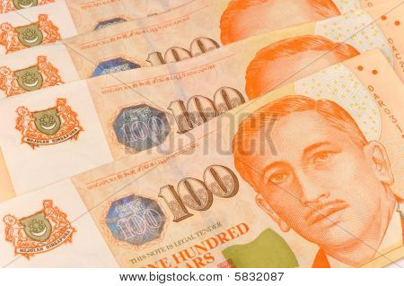 close up shot of hundred singapore dollar notes