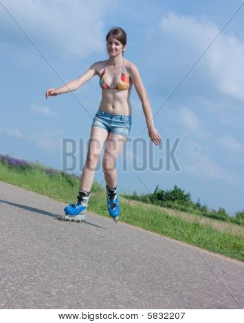 Sporting Girl On Roller Blades