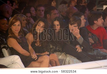 Penelope Cruz with Demi Moore and Ashton Kutcher inside at the 2006 GM TEN Fashion Show. Paramount Studios, Hollywood, CA. 02-20-07
