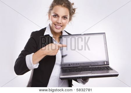 Pretty Businesswoman Holding Laptop