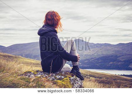 Woman Relaxing On Mountain Top