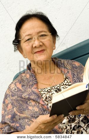 Happy Senior Woman Read Book