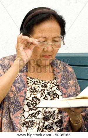 Elderly Woman read book