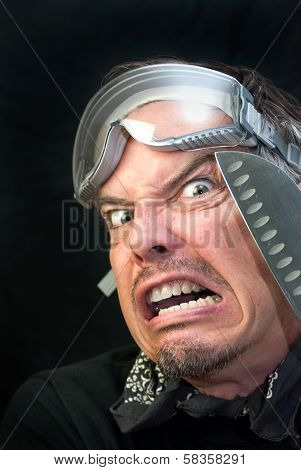 Man In Goggles With Knife, Afraid