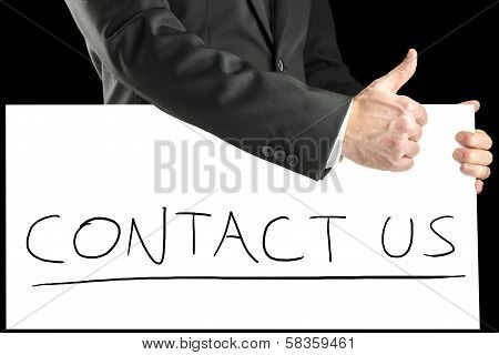 Businessman With A Handwritten Contact Us Sign