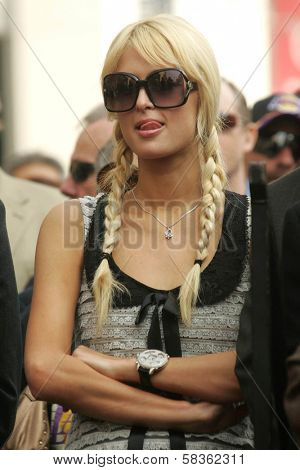Paris Hilton at the Ceremony Honoring Los Angeles Lakers Owner Jerry Buss with the 2,323rd star on the Hollywood Walk of Fame. Hollywood Boulevard, Hollywood, CA. 10-30-06