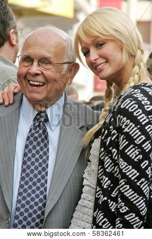 Johnny Grant and Paris Hilton at the Ceremony Honoring Los Angeles Lakers Owner Jerry Buss with the 2,323rd star on the Hollywood Walk of Fame. Hollywood Boulevard, Hollywood, CA. 10-30-06