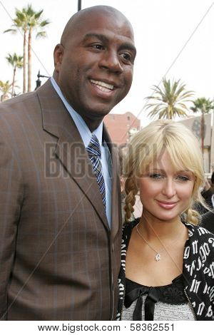 Magic Johnson and Paris Hilton at the Ceremony Honoring Los Angeles Lakers Owner Jerry Buss with the 2,323rd star on the Hollywood Walk of Fame. Hollywood Boulevard, Hollywood, CA. 10-30-06