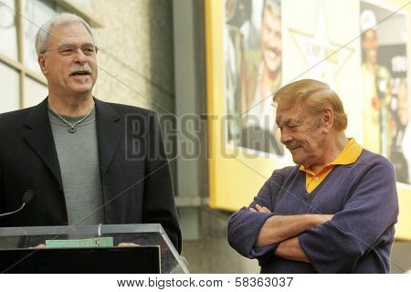 Phil Jackson and Jerry Buss at the Ceremony Honoring Los Angeles Lakers Owner Jerry Buss with the 2,323rd star on the Hollywood Walk of Fame. Hollywood Boulevard, Hollywood, CA. 10-30-06