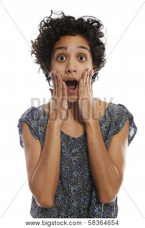 Portrait Of Shocked Hispanic Woman With Mouth Open
