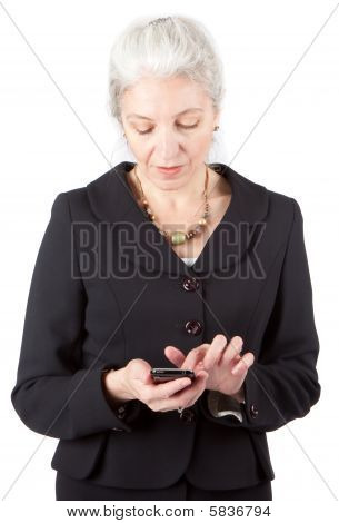 Senior Businesswomen Uses Cell Phone on white back