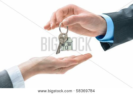 Man Is Handing A House Key To Other Hands