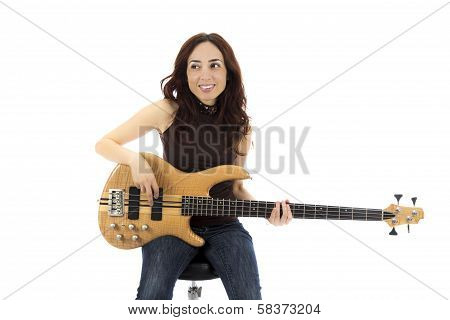 Smiling Young Woman With A Bass Guitar
