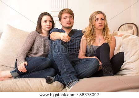 Three Teenage Students Watching Television