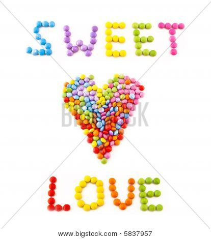 Inscription Love From Multi Coloured Chocolate Candy