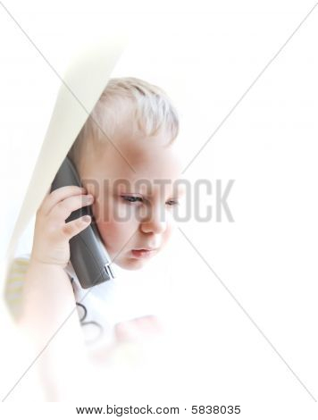 The Beautiful Child On A White Background Speaking By Phone