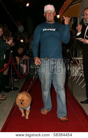 Johnny Mitchell and dog Austin at the first annual Beverly Hills Mutt Club Fashion and Halloween Show, Beverly Hills Mutt Club, Beverly Hills, CA 10-22-06